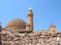 Old mosque. With minaret and stone wall stock images