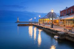 Old mosque in Chania port at dawn on Crete. Architecture of Chania at night with Old Venetian port on Crete. Greece Royalty Free Stock Photography