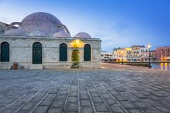 Old mosque in Chania port at dawn on Crete. Greece Stock Photos