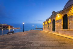 Old mosque in Chania port at dawn on Crete. Old mosque in Chania port at night on Crete, Greece Stock Photos