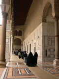 Old mosque in Damascus, Syria. Muslim people in the Umayyad mosque in Damascus, Syria Stock Image