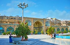 The old Mosque in Tehran Grand Bazaar. TEHRAN, IRAN - OCTOBER 11, 2017: The Shah`s Mosque with its spacious courtyard is surrounded by dense buildings of Grand Royalty Free Stock Photography