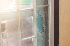 Old Mosquito wire screen lacking. In house Stock Photography
