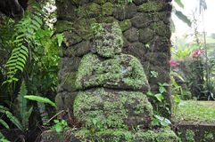 Old mossy guardian stone statue Stock Photo