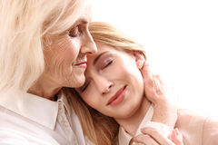 Old mother necking her daughter Stock Photography