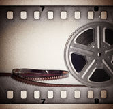 Old motion picture film reel with film strip Royalty Free Stock Photo