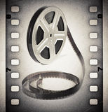 Old motion picture film reel with film strip Royalty Free Stock Image