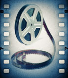Old motion picture film reel with film strip. Royalty Free Stock Photo