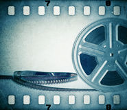 Old motion picture film reel with film strip. Vintage background Stock Photos