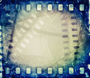 Old motion picture film reel with film strip. Royalty Free Stock Image