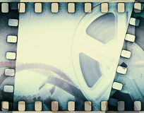 Old motion picture film reel with film strip. Stock Photos