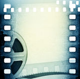 Old motion picture film reel. With film strip Royalty Free Stock Photography