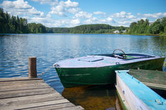 Old motor boat on the lake Stock Photos