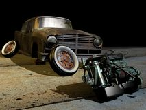 Old motor and car. An old motor car and a broken old abandoned car Royalty Free Stock Photo