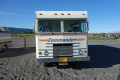 An old motor-home parked on a beach in alaska. Royalty Free Stock Image