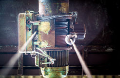 Old motor for hook. Old motor to hook in an abandoned warehouse Stock Images