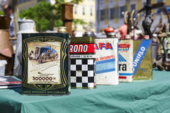 Old motor oil cans for sale in Nice, France Stock Image