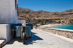 Old motor with trailer. View of the Greek beaches and bay. Old motor with trailer. View of the Greek beaches and bay in Lindos, Rhodes island stock photo