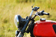 Old motorbike. Detail view of a typical custom motorbike Royalty Free Stock Images