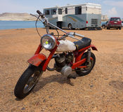 An old motorbike on a beach in the desert. A small motorcycle at a campground at lake powell, utah Stock Photos