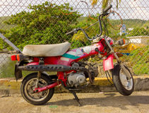 An old motorbike in the caribbean stock photography