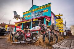 Old motorbike left abandoned at a souvenir shop on route 66 in Arizona Royalty Free Stock Images