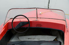 Old motorboat on the lake. Masuria. Poland. Old red motorboat on the lake. Masuria. Poland. Steering wheel from the car. Plexiglas windshield. Hull made of royalty free stock photo