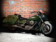 Old motorcycle. A broken old motorcycle against a brick wall Stock Photo