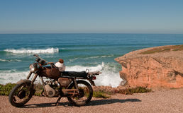 Old motorcycle. On a beach in Portugal stock images