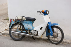 The old motorcycle at Aegina island Royalty Free Stock Photos