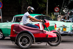 Old motorcycle in cuba streets Stock Photography