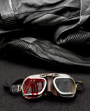 Old Motorcycle glasses and jacket royalty free stock images