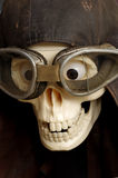 Old motorcycle goggles and helmet the skull Royalty Free Stock Image