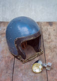 Old motorcycle helmet. And headlight Royalty Free Stock Photography