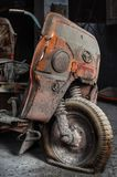 Old motorcycle. Old motor bike with flat tire discovered in deserted factory in China stock images