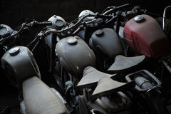 Old motorcycle in a row. Old black and red motorcycle standing in a row in garage, horizontal picture stock image