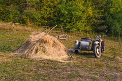 Old motorcycle with sidecar and haystack Stock Photos