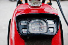 Old motorcycle speedometer. Close up of the dashboard at red cyc Royalty Free Stock Images