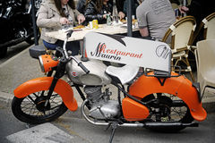 Old motorcycle using menu door in a restaurant Stock Photos