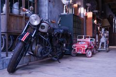 Old motorcycle in vintage style. Background Stock Images