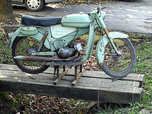 The old  motorcycles. The old rusty motorcycles on a street Royalty Free Stock Photos