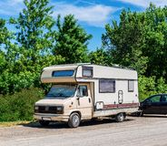 Old motorhome parked on the roadside. Hungary stock photography