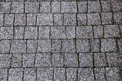 Old mottled granite surface from cobblestone Stock Images