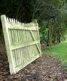 Old Mouldy Gate. A view of an old green mouldy gate in a forest setting Royalty Free Stock Photography