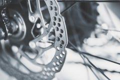 Old mountain bike front brake disc stock photo