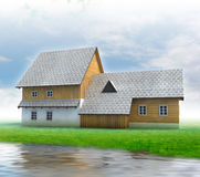 Old mountain cottage with green grass and river Royalty Free Stock Photo
