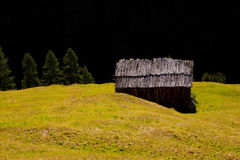 An old mountain hut. An old cottage in the Alps stock image