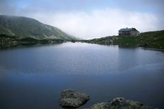 The old mountain hut of the Fish Lake. Seven Rila Lakes stock photography