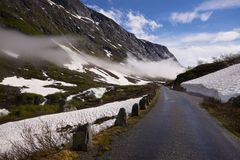 Old mountain road. Norwegian scenic road Gamle Strynefjellsvegen in early summer Royalty Free Stock Photography