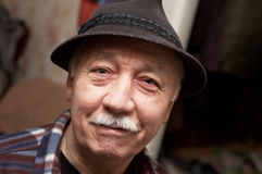 Old  moustached man in hat Stock Image